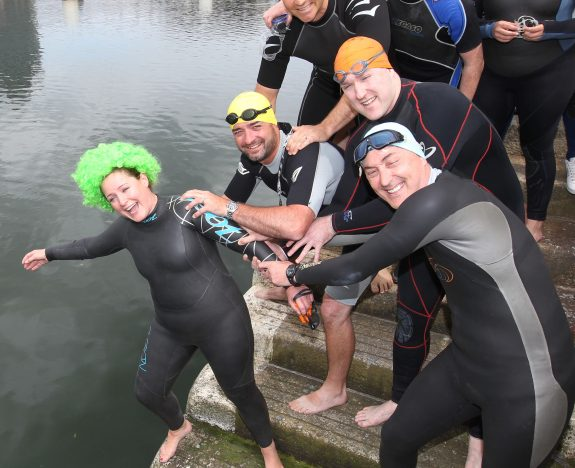 07.07.2011ÉDiving in for a great cause:Pic shows Keelin Moore as she gets a little help from her fellow swimmers at the start of the Triathlon.Over 60 O2 staff took part in a Fun Relay Triathlon Fundraiser for Headstrong in DublinÕs Docklands today. Starting at O2Õs head office, O2 employees swam across the Liffey, cycled from there to The O2 and raced on foot back to the Samuel Beckett Bridge. O2 entered a major new three year partnership with Headstrong in September last.Ê Together, Headstrong and O2 have devised the Think Big programme, which encourages young people to do projects in their community to promote positive mental health. More details Êcan be found at www.o2thinkbig.ie.Pic mAxwells Dublin No Fee Pic .